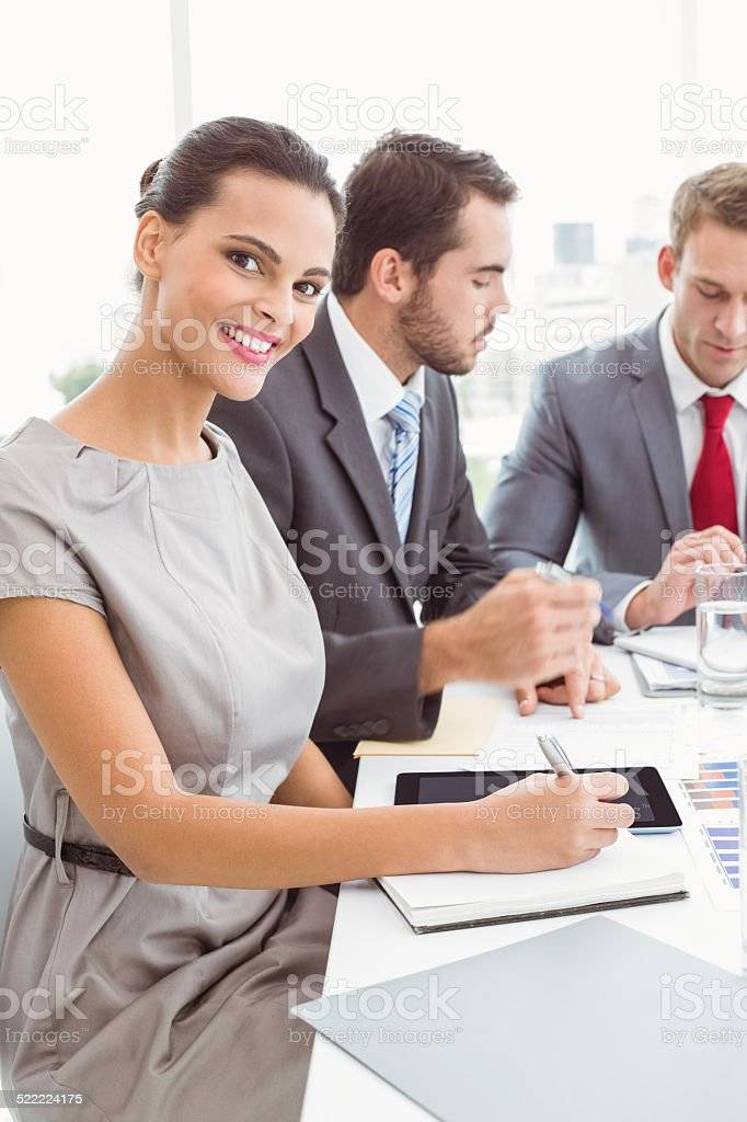 Business people writing notes in board room meeting stock photo