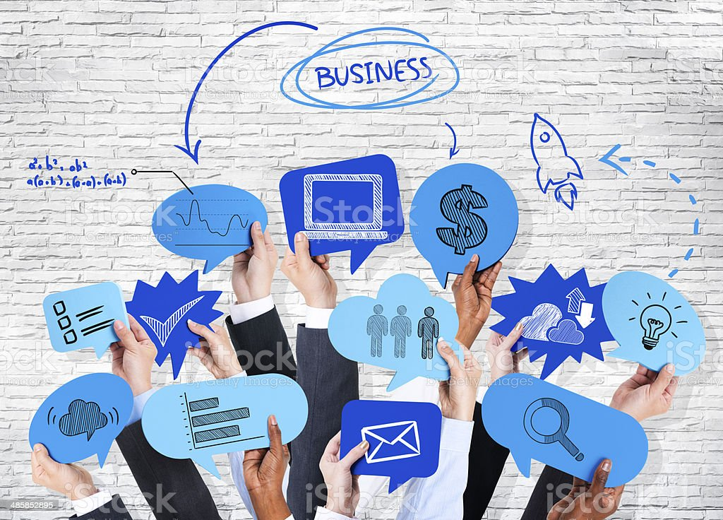 Business People's Hands Holding The Speech Bubble With Business stock photo