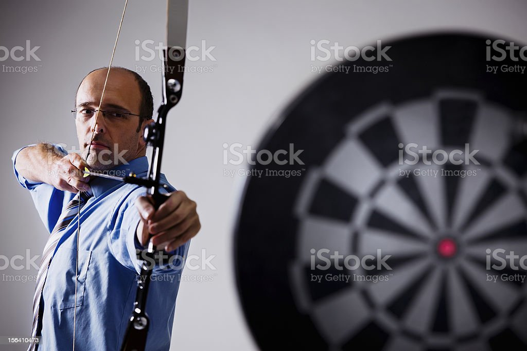 Business person aiming at target. royalty-free stock photo