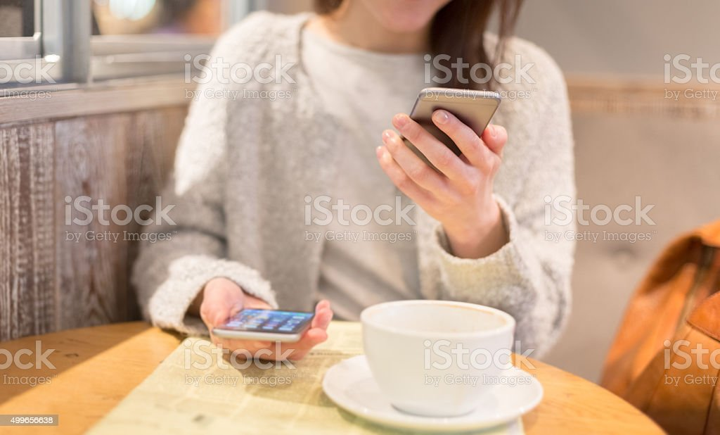 Business person at coffee break using smartphones stock photo