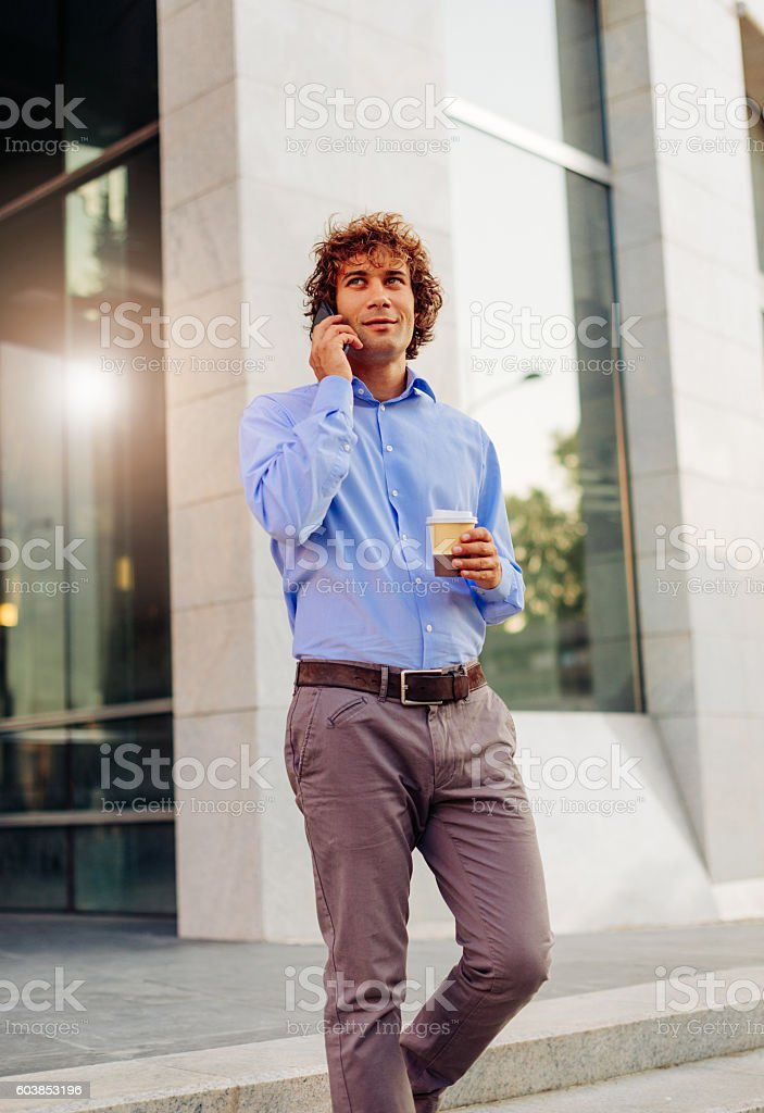 Business person coming out of the office building stock photo