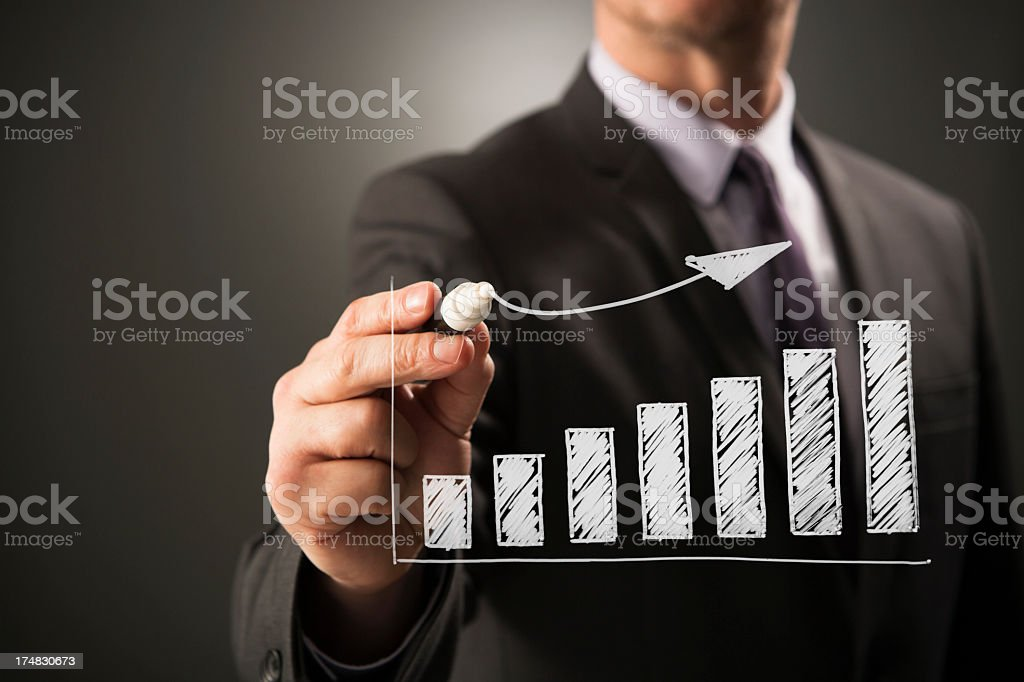 Business person drawing ascending bar chart royalty-free stock photo