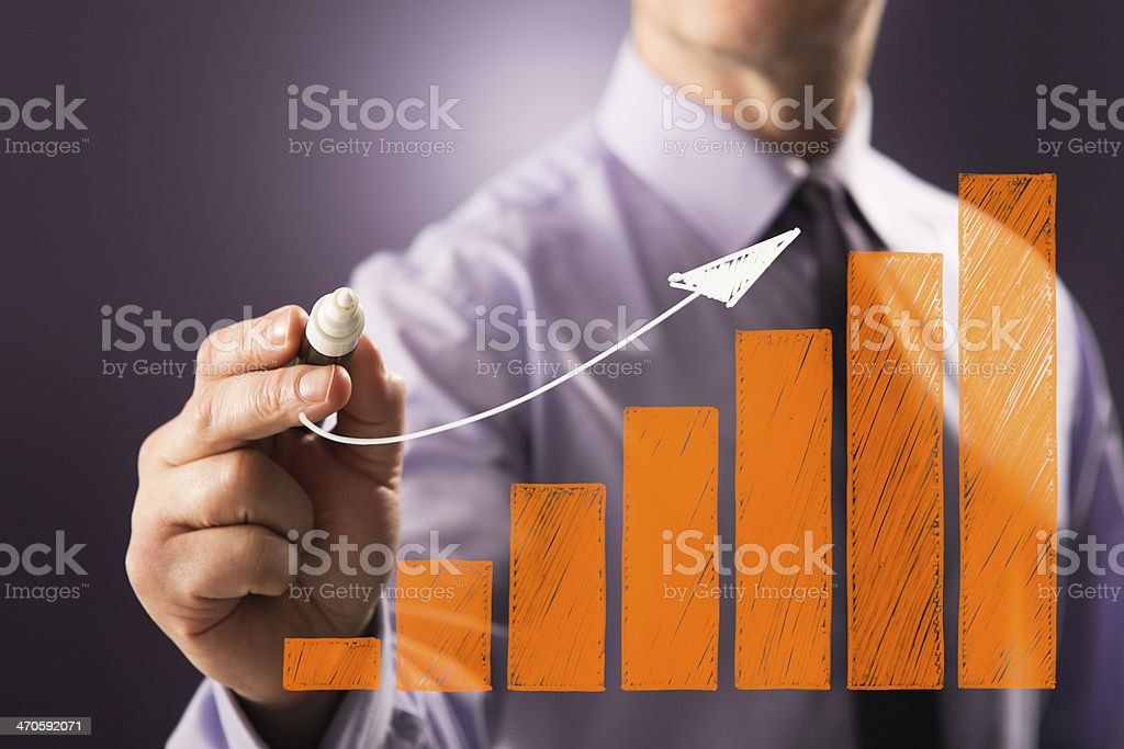 Business person drawing profit graph stock photo