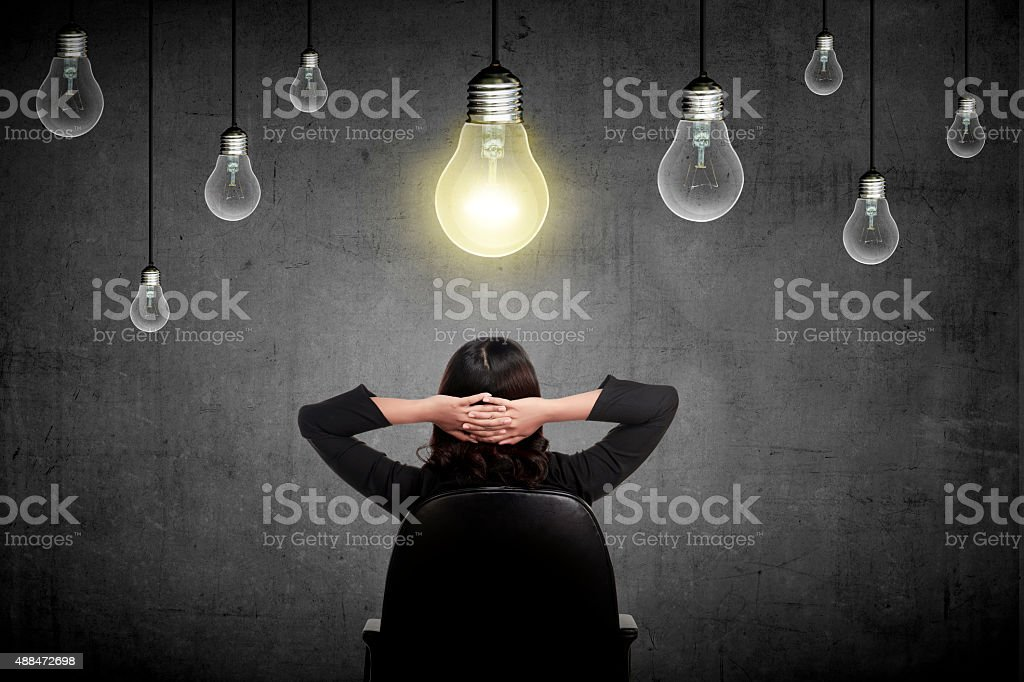 Business person having bright idea stock photo