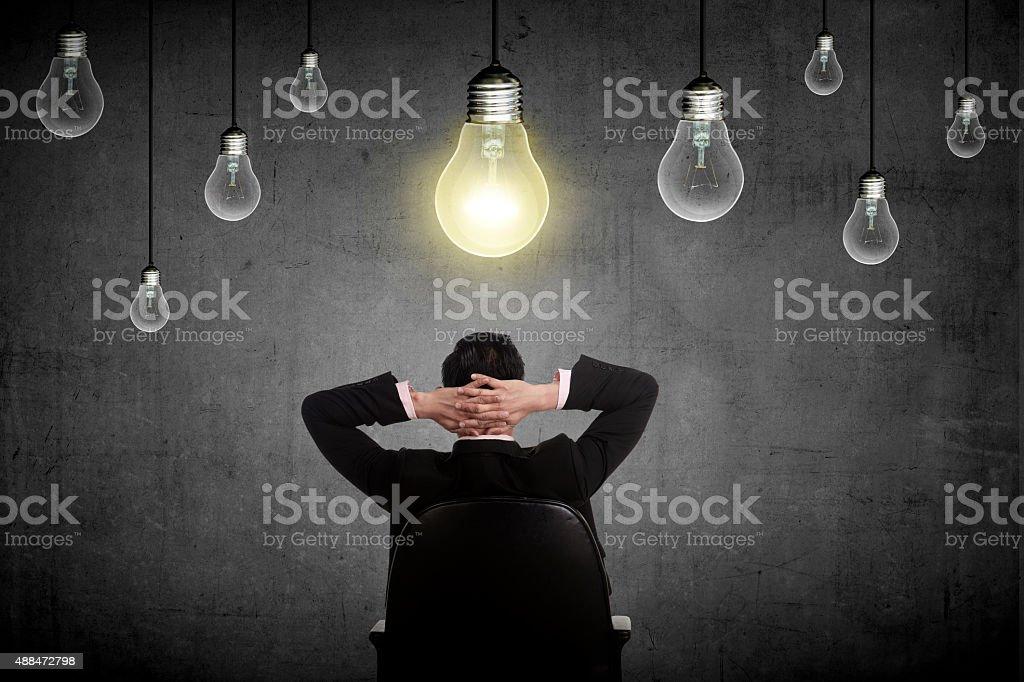 Business person having bright idea stock photo