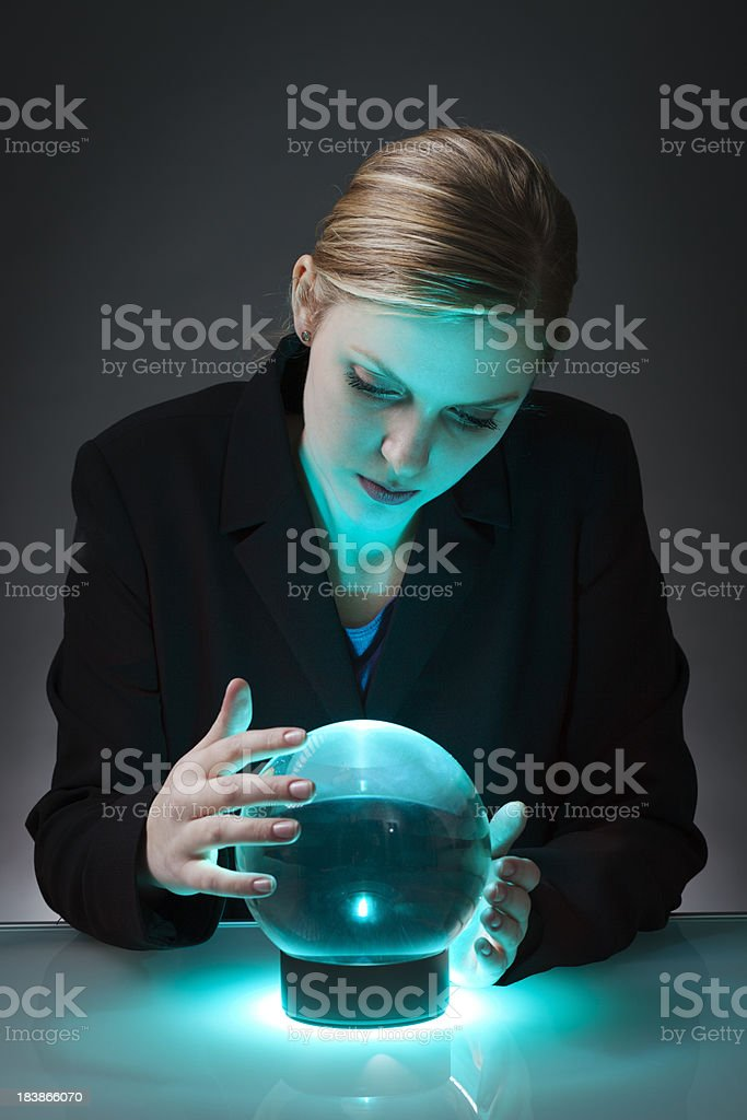 Business Person Looking into Crystal Ball to Forecast the Future royalty-free stock photo