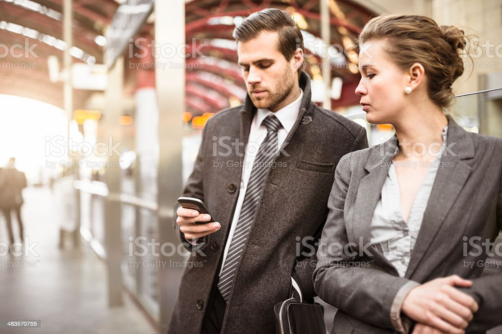 Business person on the phone at station stock photo