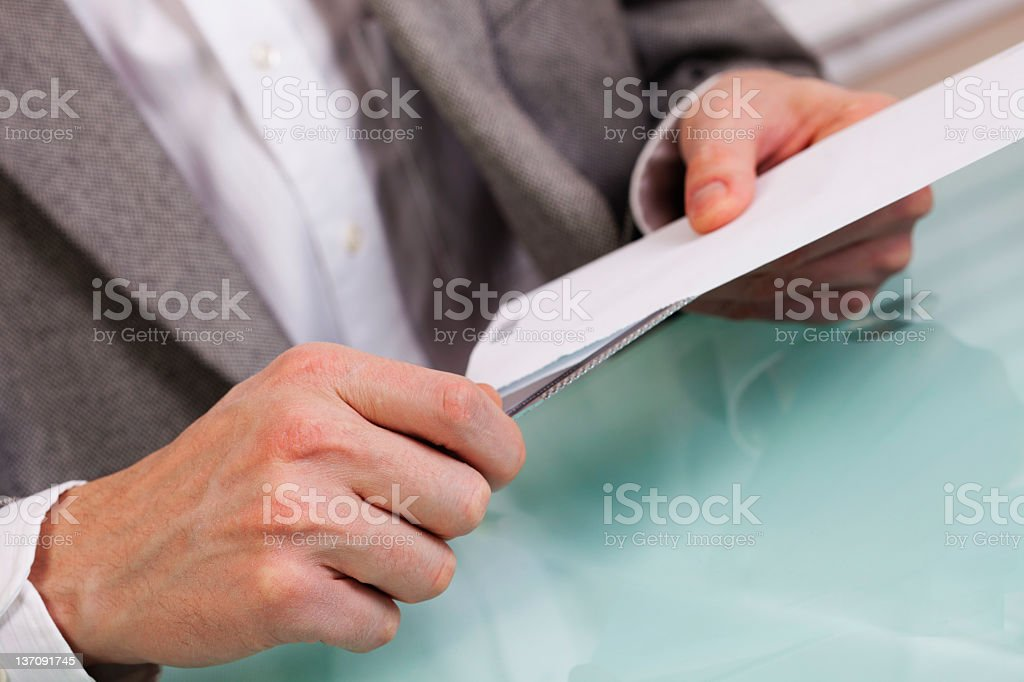 Business person opening an envelope stock photo