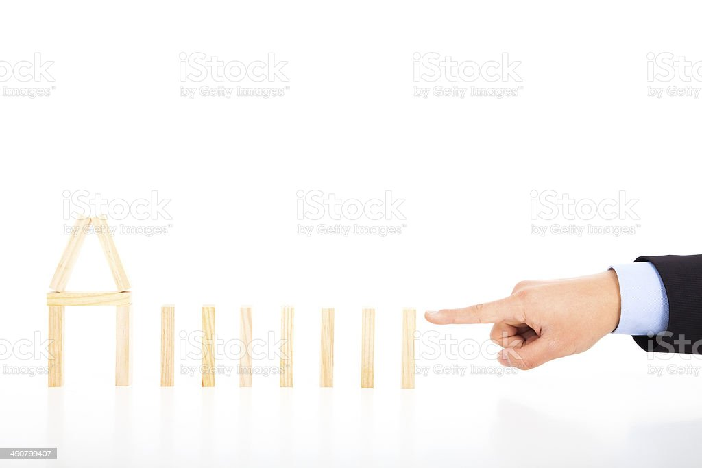 business person ready to push dominoes in a row royalty-free stock photo