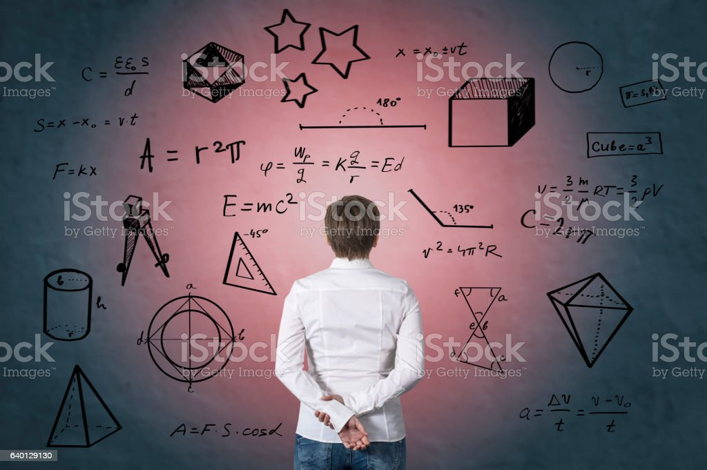 Business person standing in front of mathematical formula. stock photo