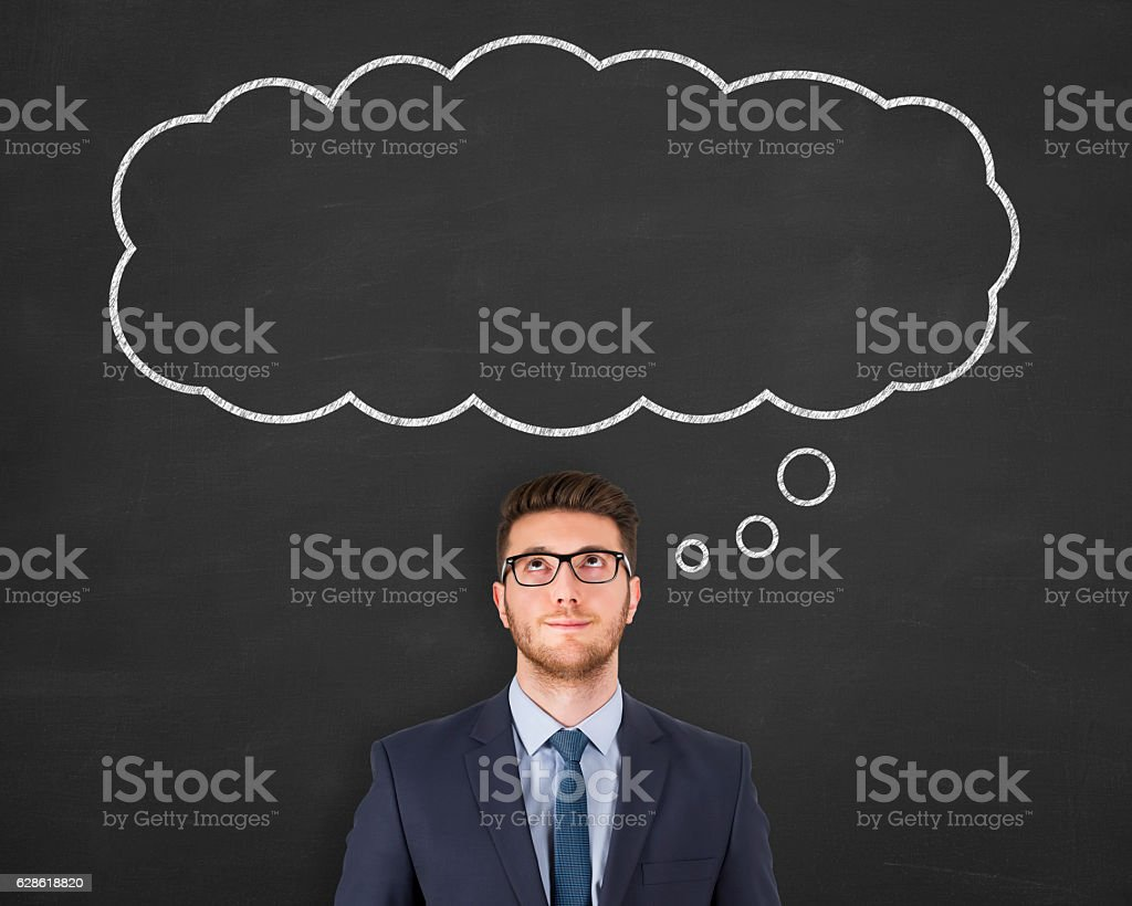 Business Person standing next to thought bubble drawn over head stock photo