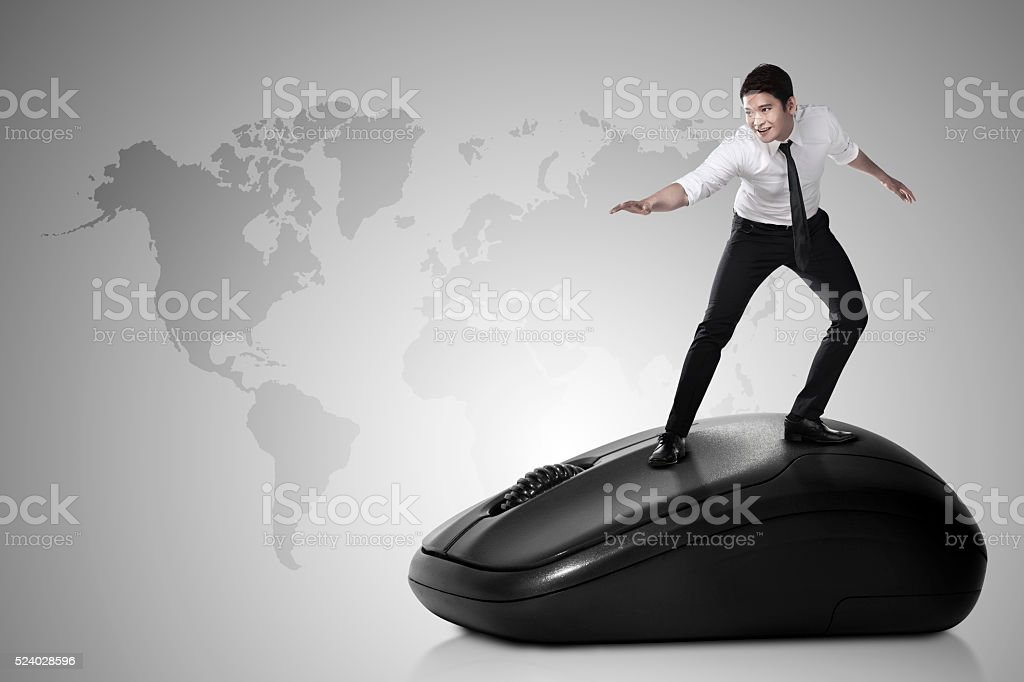 Business person surfing with computer mouse stock photo