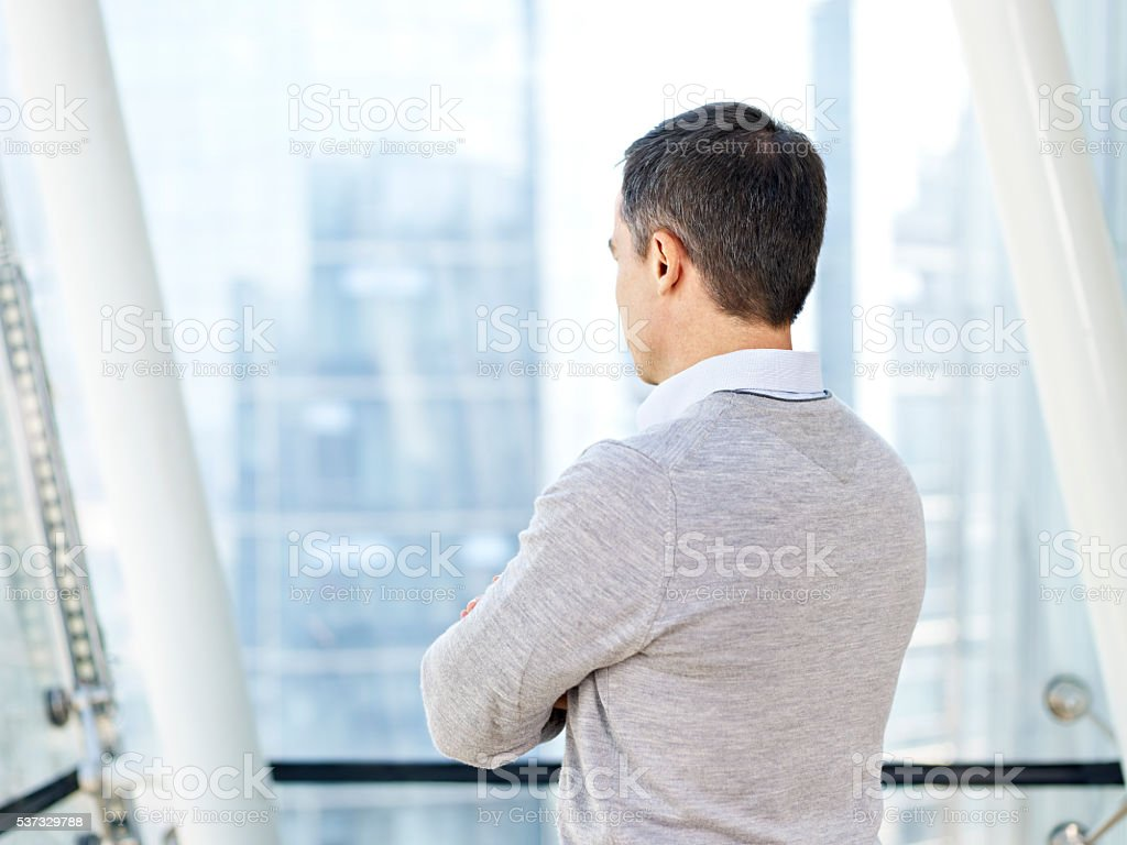 business person thinking by the windows stock photo