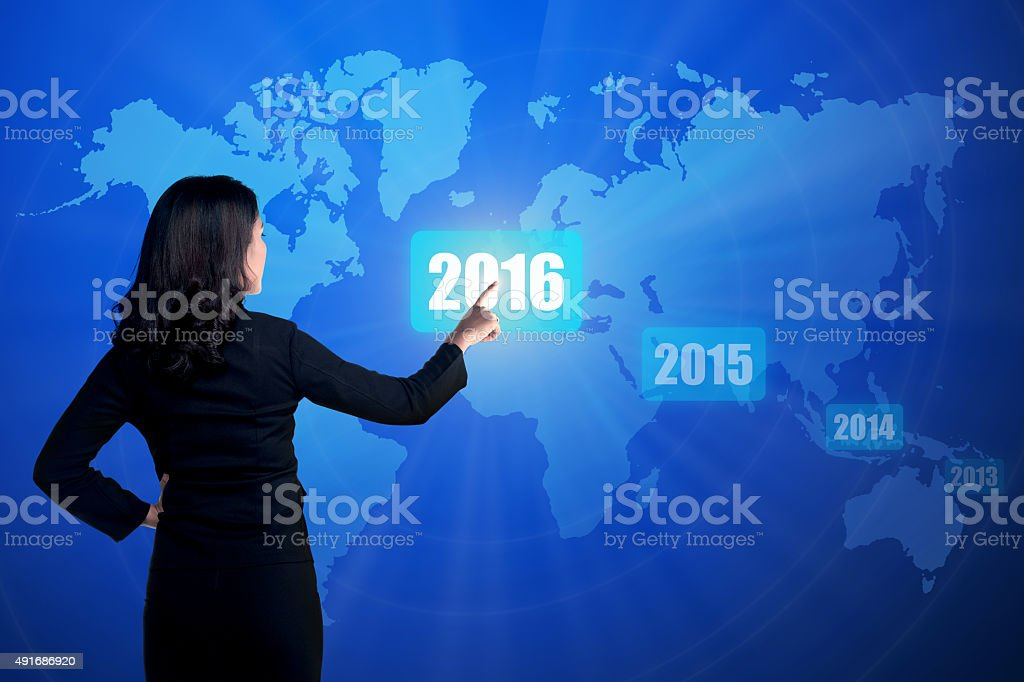 Business person touching 2016 year button stock photo