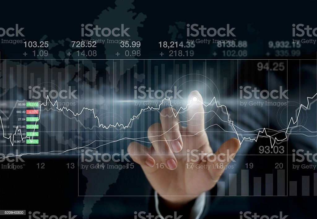 Business person touching charts and diagrams stock market stock photo