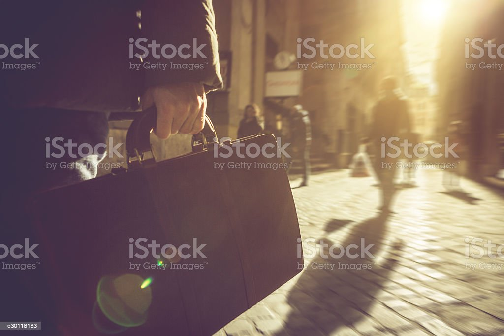 Business person walking with briefcase in Rome stock photo
