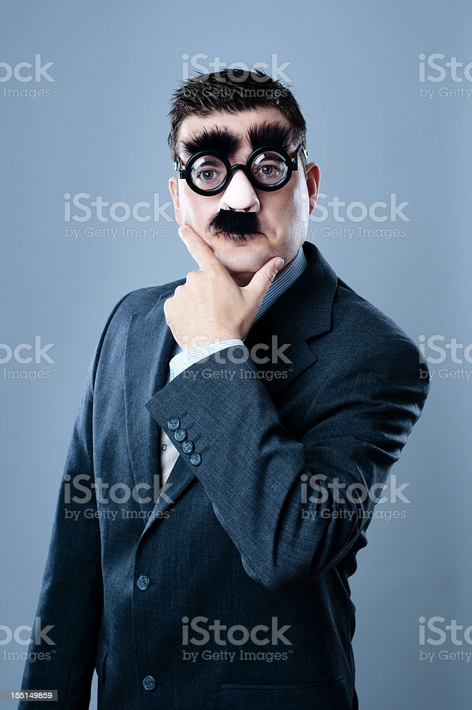 Business person with fake nose and mustache stock photo