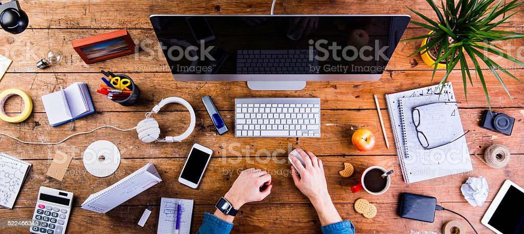 Business person working at office desk wearing smart watch stock photo