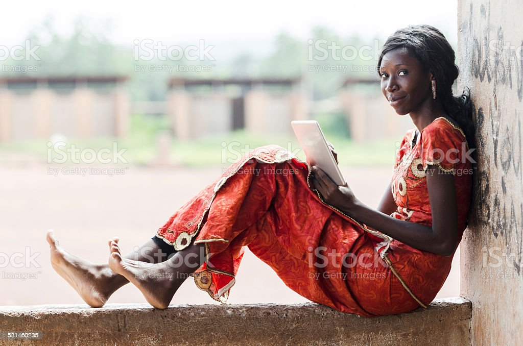Business Person Working In School for Lesson (African Student Typing) stock photo