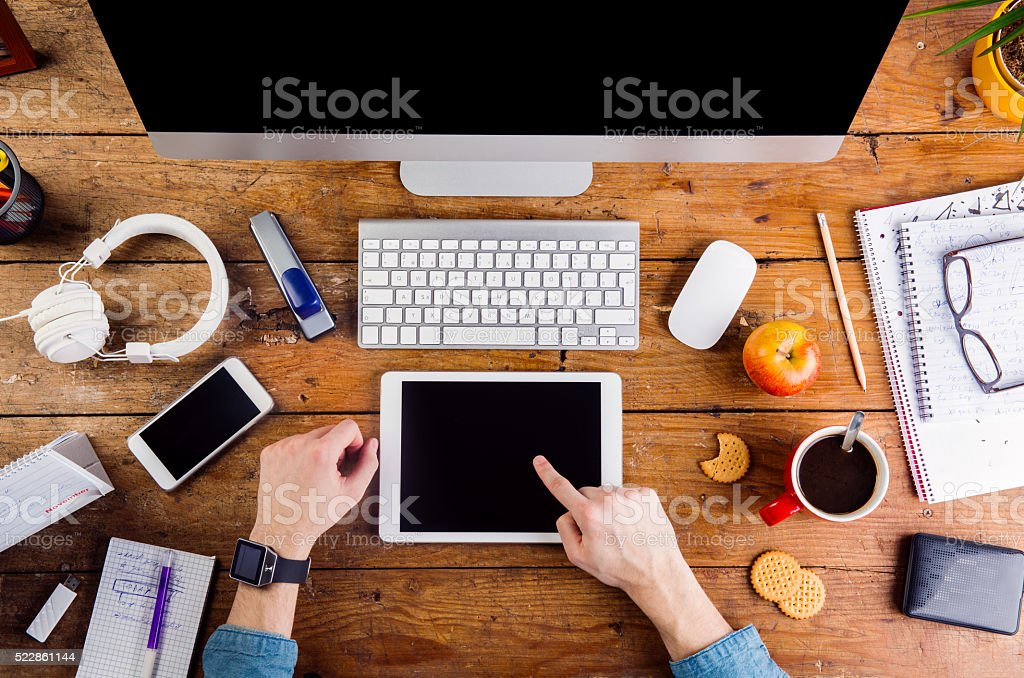 Business person working on tablet wearing smart watch stock photo