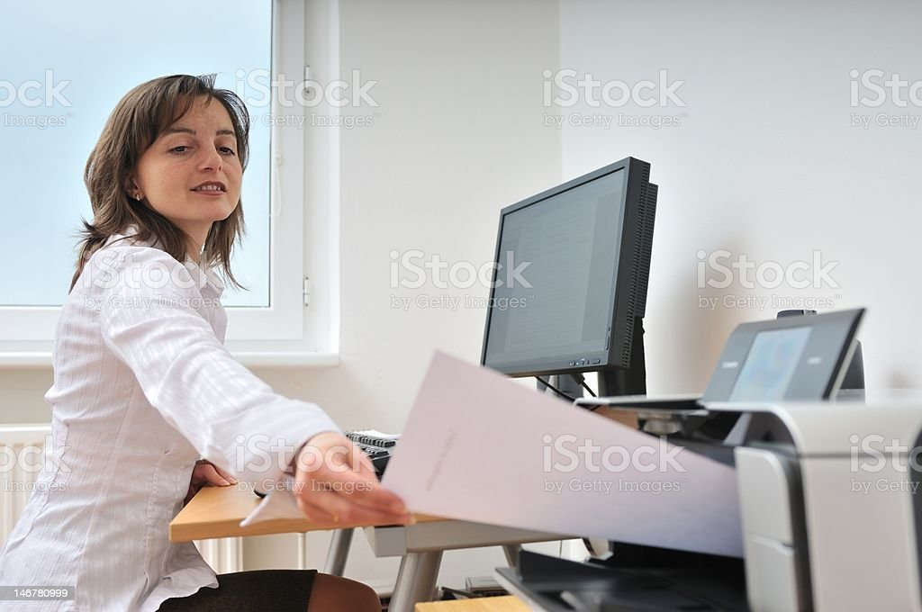 Business person working with printer stock photo
