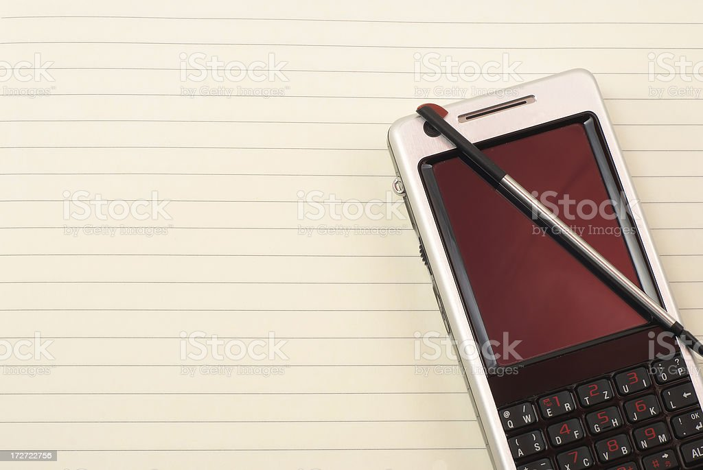 Business phone on sheet of paper royalty-free stock photo