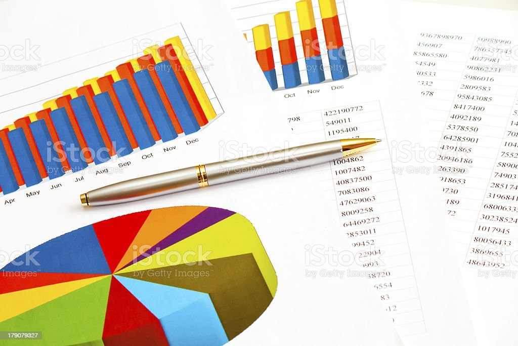 Business picture: pen and financial graphs royalty-free stock photo