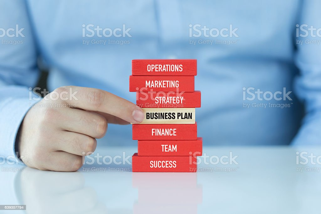 Business Plan Concept with Related Keywords on Wooden Blocks stock photo