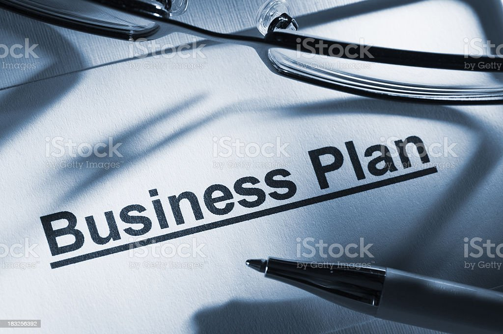 Business plan paperwork with glasses and pen royalty-free stock photo