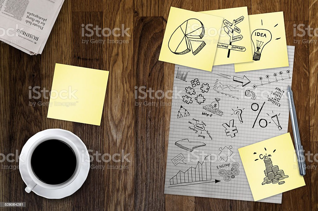 Business plans and tablet on old table stock photo