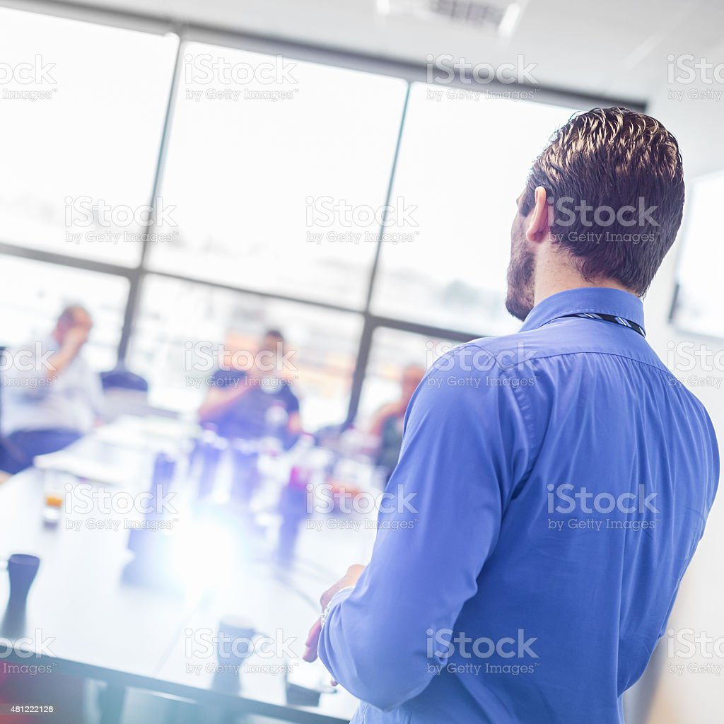 Business man making a presentation at office. Business executive...