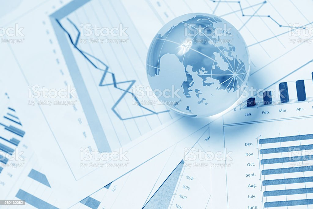 Business presentation with glboe and chart on the desk stock photo
