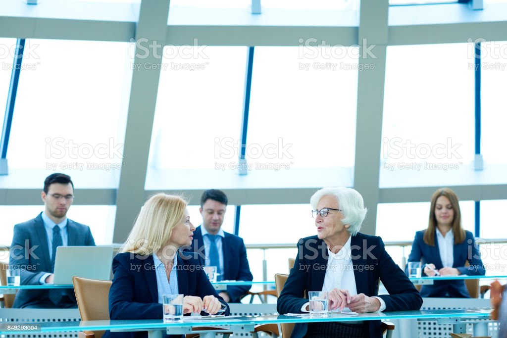 Business professionals arguing at conference stock photo