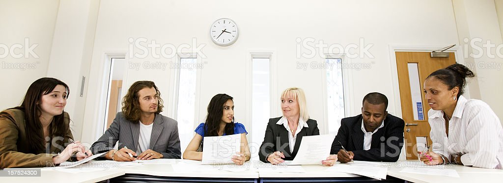 Business professionals meeting about adult education royalty-free stock photo