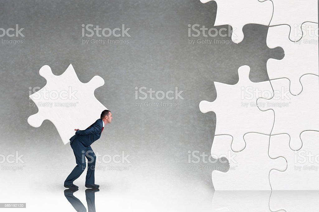 business puzzle concept with businessman and jigsaw stock photo