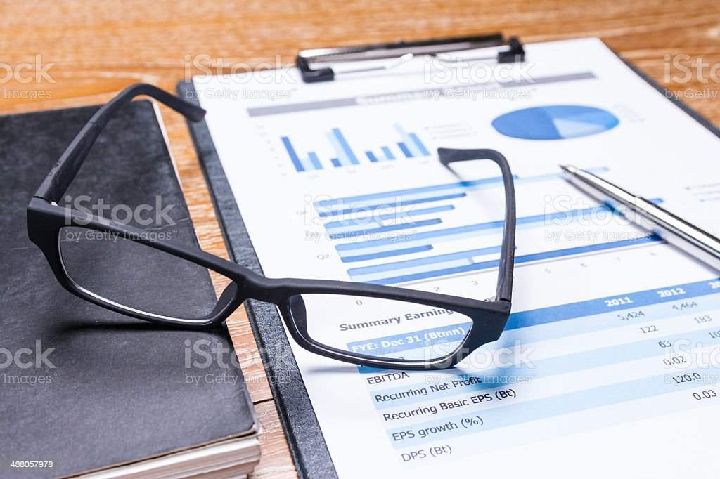business report on table stock photo