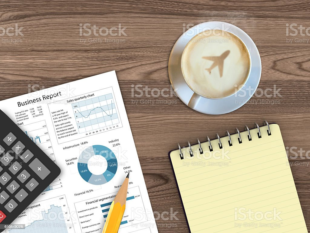 Business report wooden desk top view travel vacation stock photo