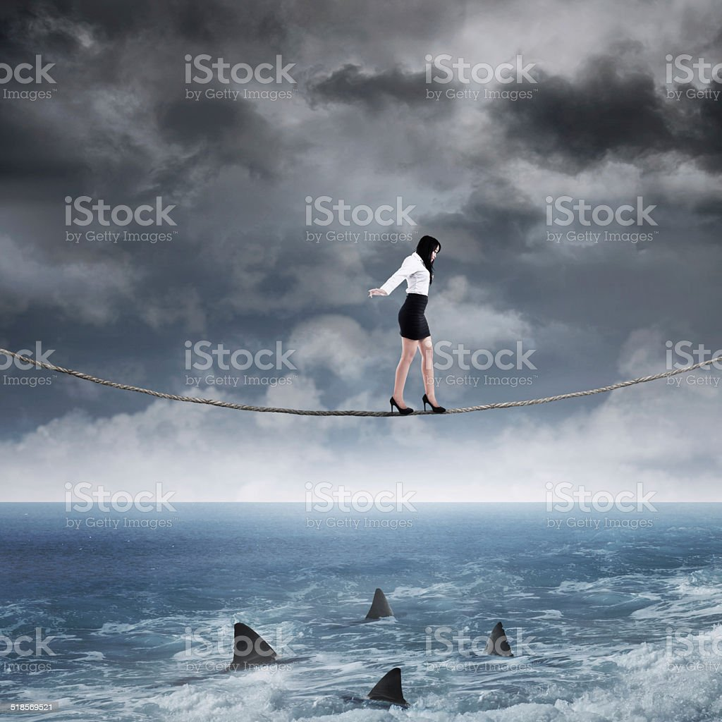 Business risk with woman on the rope stock photo