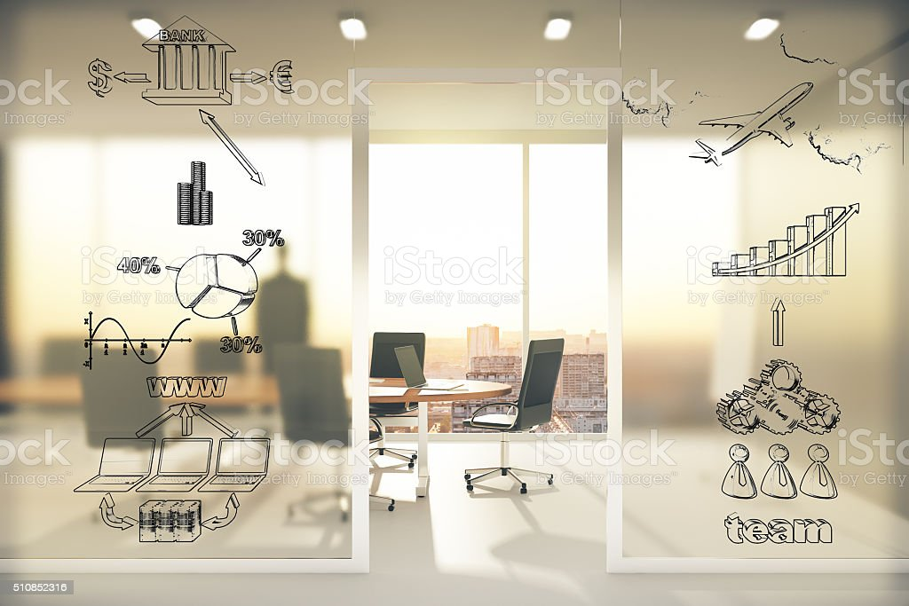 Business scheme concept on transparent wall in conference room a stock photo