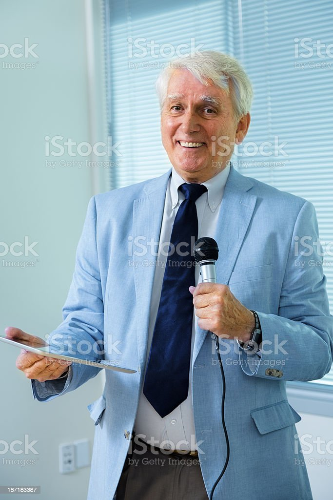 Business: Senior businessman gives speech at staff meeting. royalty-free stock photo