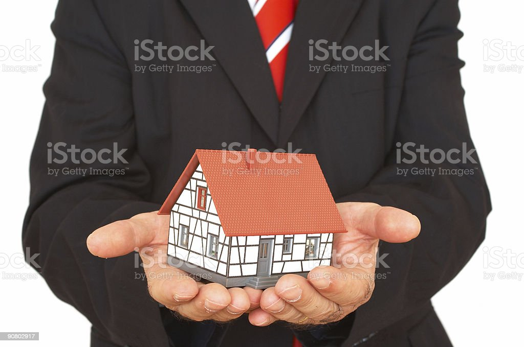 business series: businessman with house stock photo