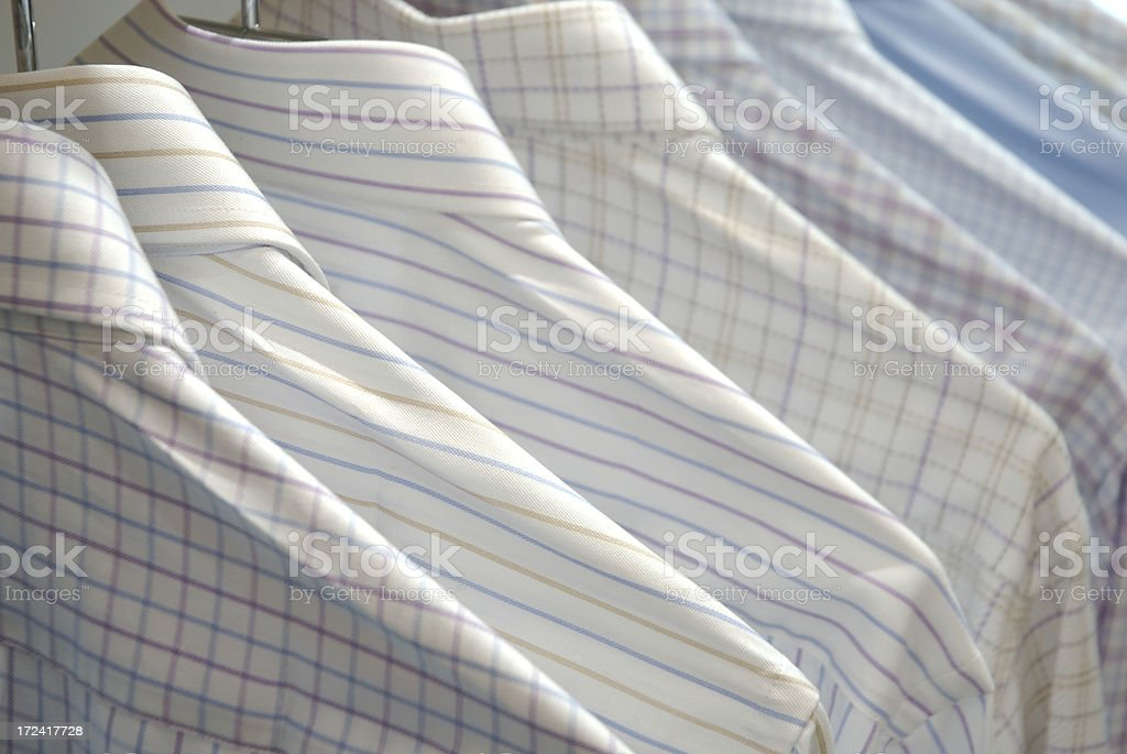 Business Shirts for the Week Hanging in a Row royalty-free stock photo