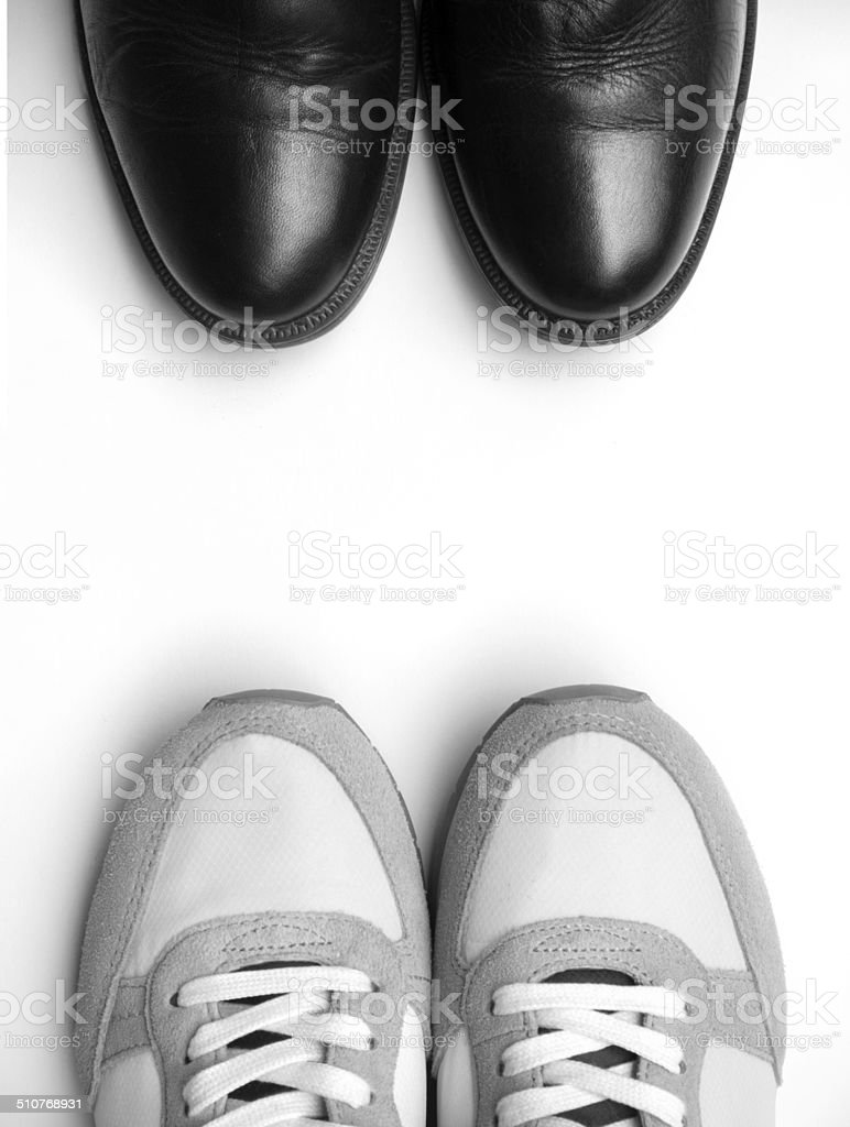 business shoes and sneaker close up on white stock photo