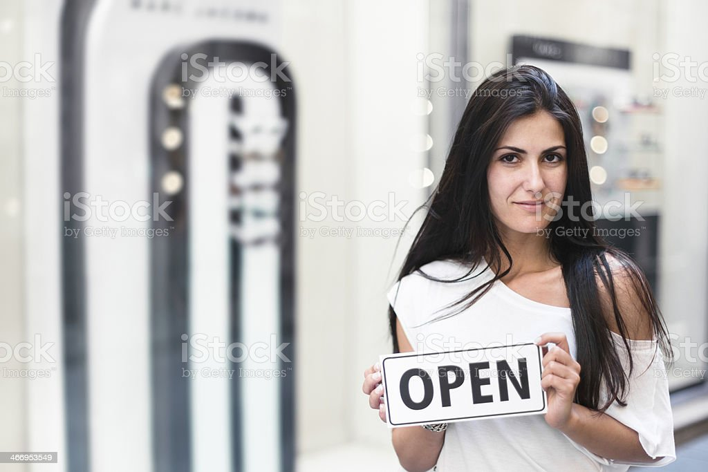 Business shop owner in front of her store royalty-free stock photo