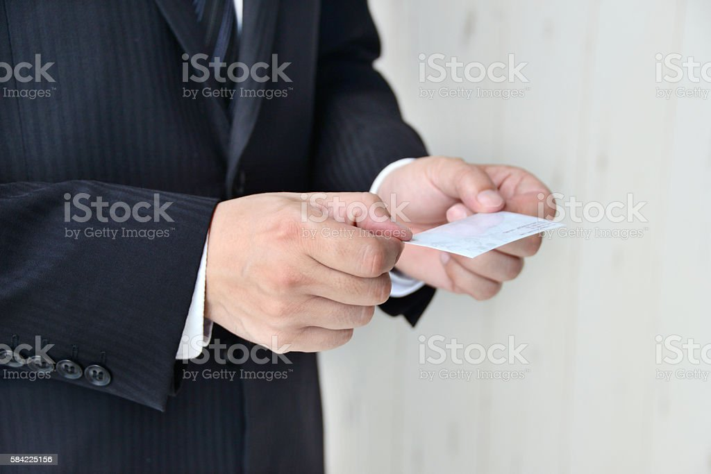 Business situation, exchanging business card stock photo
