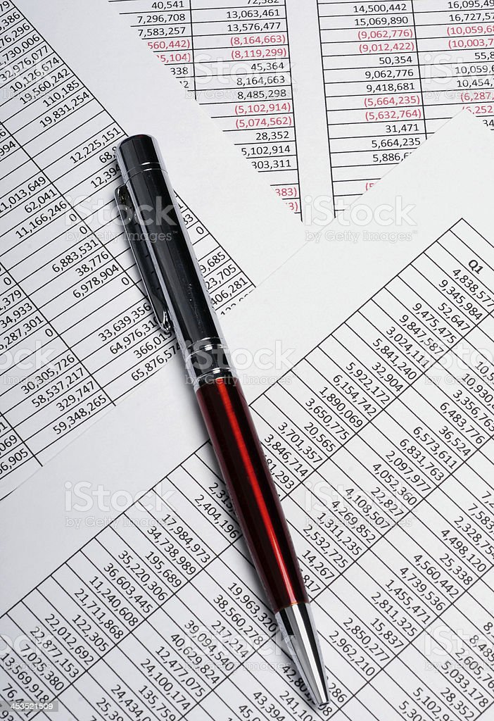 Business spreadsheets with pen royalty-free stock photo