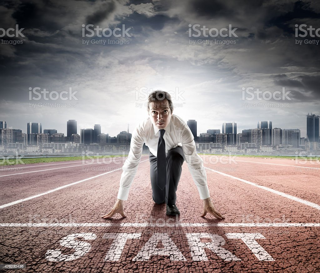 business start - businessman ready for competition stock photo