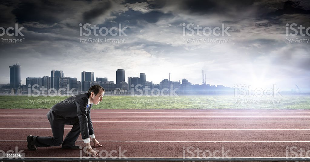 business start - businessman ready for competition - side view stock photo