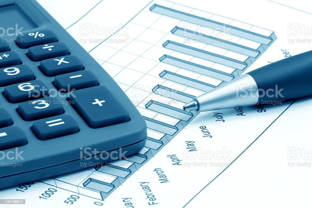Business still-life with calculator and pen (blue toned) royalty-free stock photo