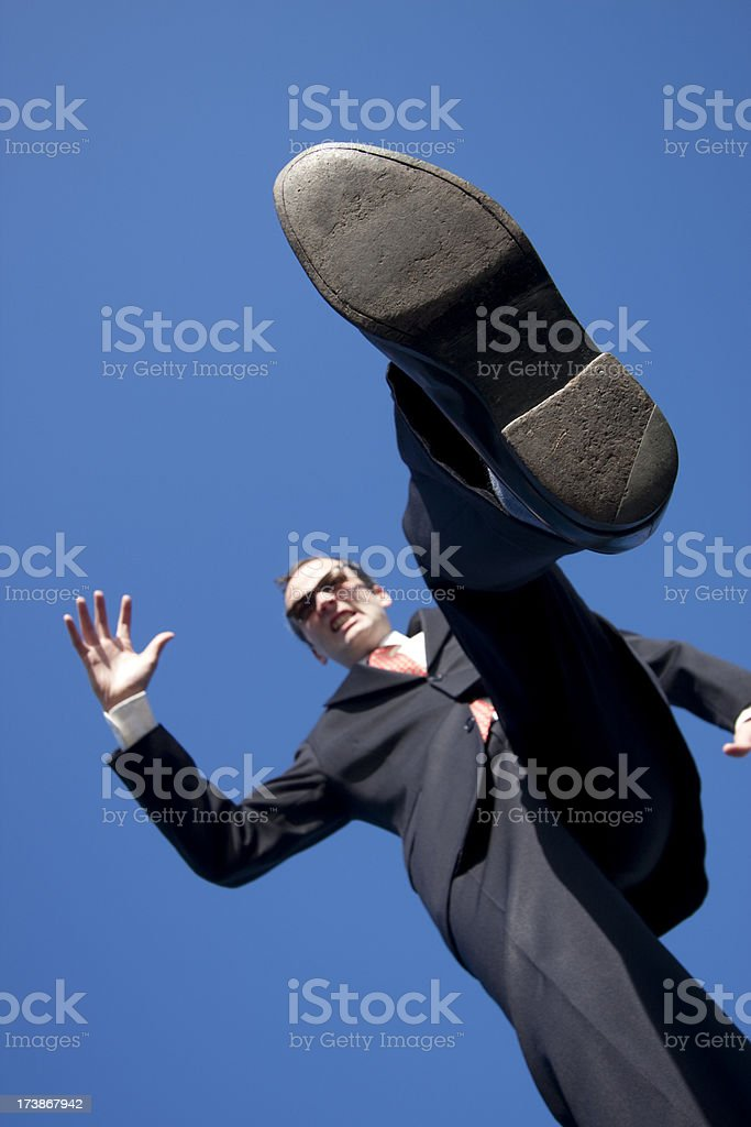 Business Stomping on the Little Guy stock photo